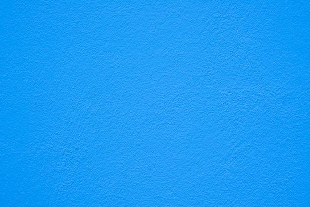 Struttura blu del muro di cemento o del cemento per priorità bassa.