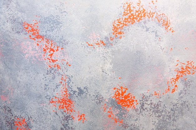 Struttura concreta grigia con punti rossi. muro di cemento