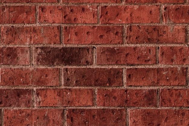 Struttura concreta ruvida della casa del muro di mattoni