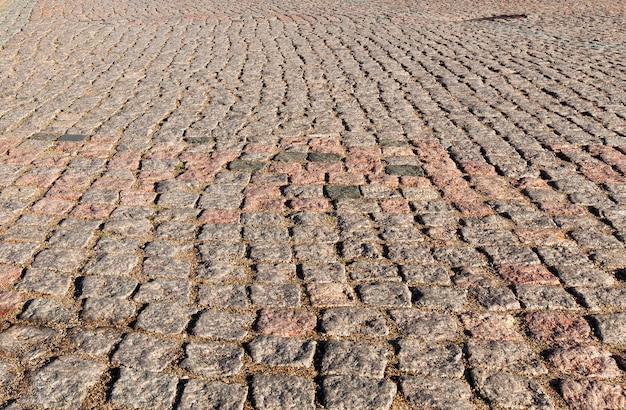 Struttura dei mattoni dei ciottoli delle mattonelle della pavimentazione di pietra