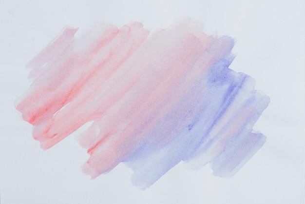 Struttura del colpo dell'acquerello sfumatura blu e rosso