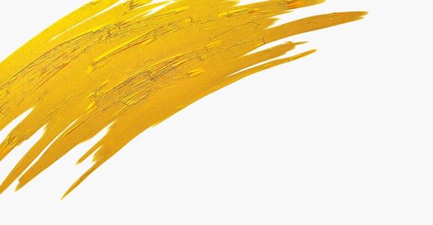 Struttura del colpo della spazzola dell'oro su fondo bianco