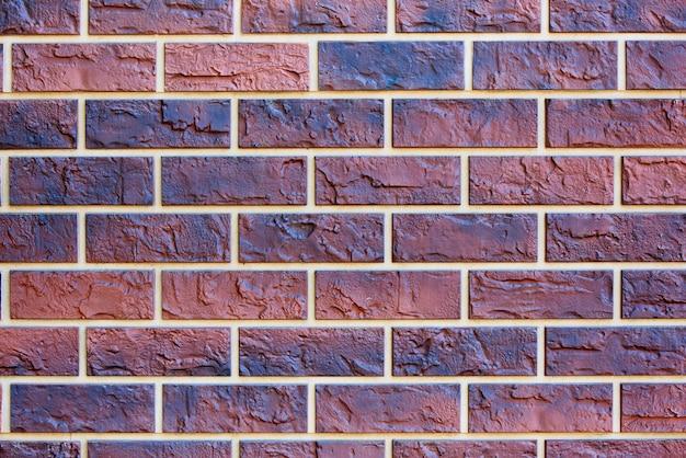 Struttura del fondo del muro di mattoni colorato.