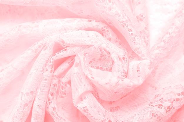 Struttura del fondo del tessuto delicato del pizzo della fine rosa di colore su. focalizzazione morbida.