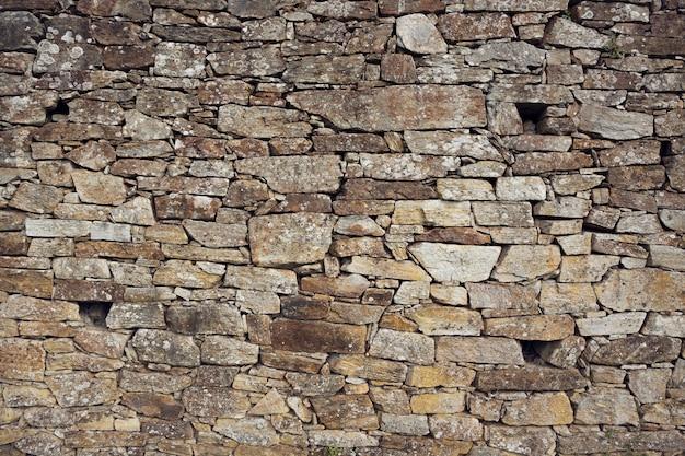 Struttura del fondo della parete di pietra asciutta della muratura