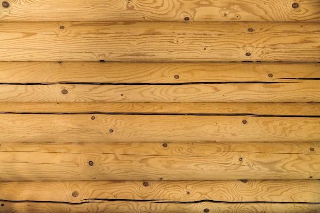 Struttura del fondo della parete interna della casa di ceppo di legno di pino chiaro
