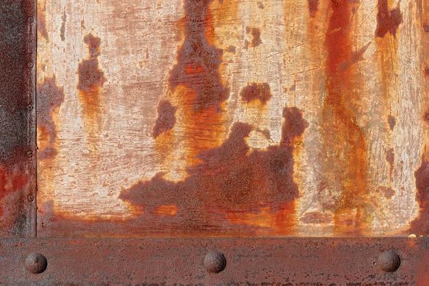 Struttura del fondo di vecchio metallo con il primo piano della ruggine.