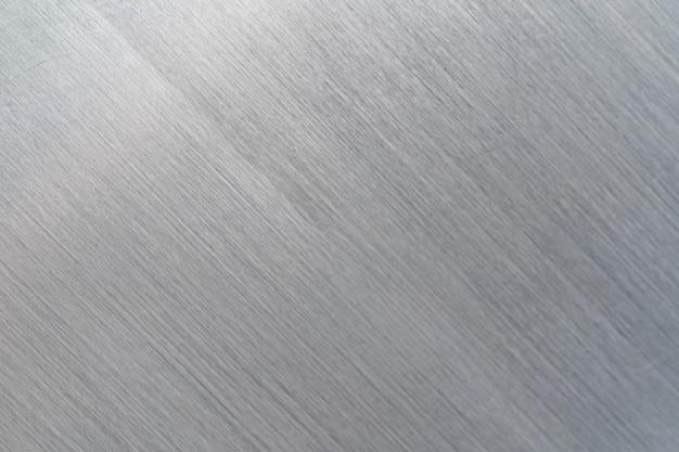Struttura del metallo graffiato, sfondo di piastra in acciaio spazzolato