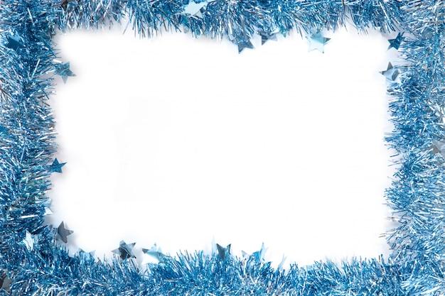 Struttura del nuovo anno di lamé blu su fondo bianco