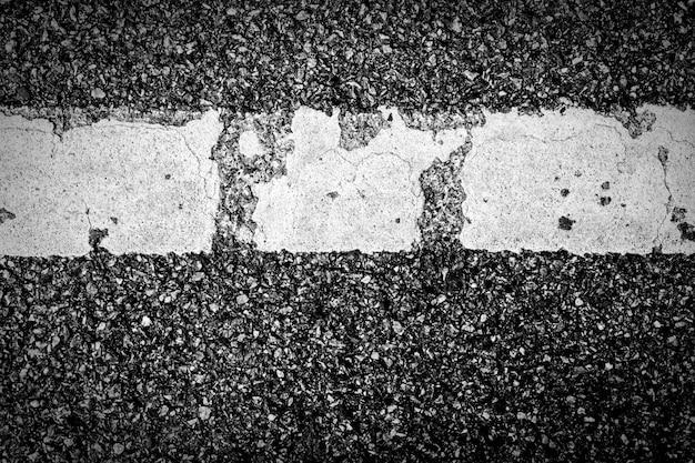 Struttura dell'asfalto con linea tratteggiata bianca