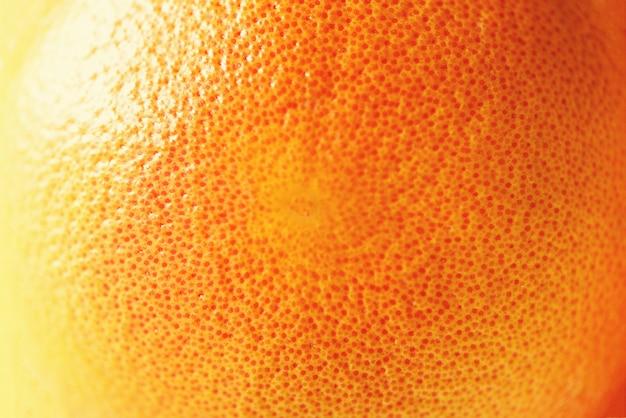 Struttura della buccia d'arancia luminosa fresca, primo piano, spazio della copia. macro di frutta arancione. agrumi