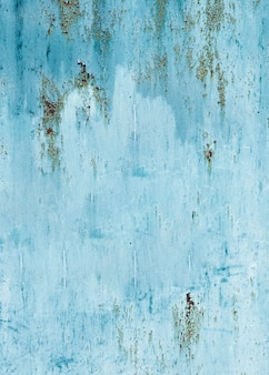 Struttura della parete dipinta blu chiaro con le crepe
