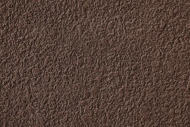 Struttura della parete intonacata cemento marrone grezzo