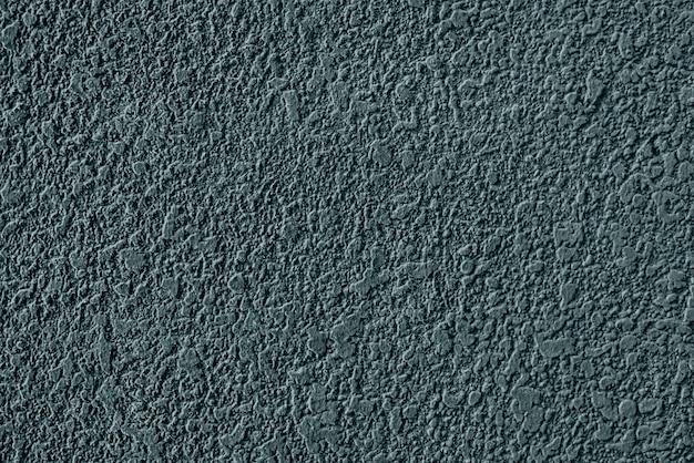 Struttura della parete intonacata cemento verde grezzo