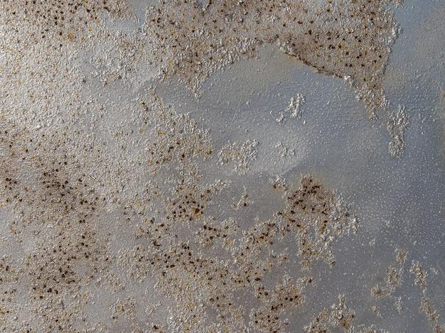 Struttura della superficie della parete di metallo arrugginito.