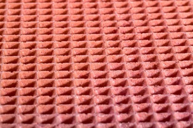 Struttura della superficie e del fondo di una cialda della confetteria nel colore rosa