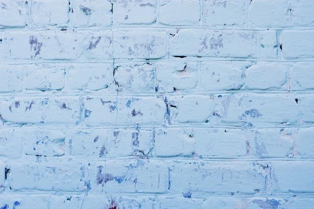 Struttura della vecchia superficie blu del muro di mattoni con le cuciture del cemento