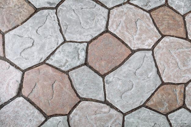 Struttura delle mattonelle grige del granito della strada