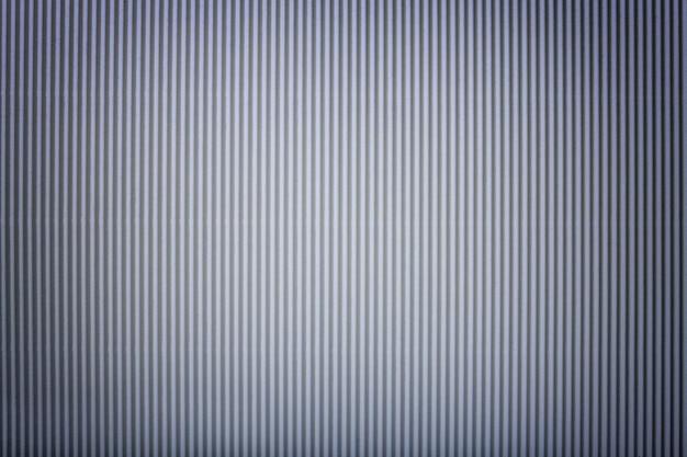 Struttura di carta d'argento ondulata con la scenetta, macro.