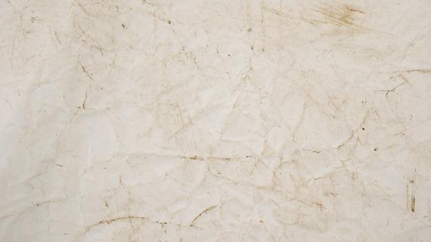 Struttura di carta ruvida del fondo di lerciume beige per progettazione
