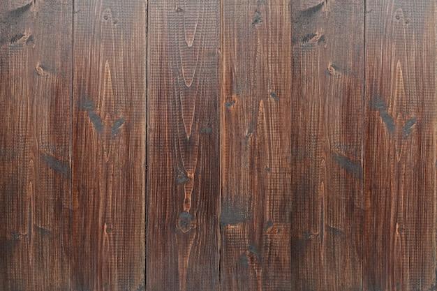 Struttura di legno della parete, fondo di legno scuro dei pannelli del recinto