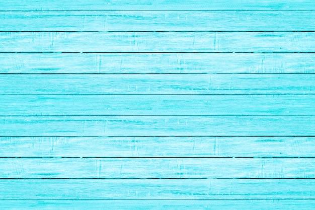 Struttura di legno della plancia di colore blu-chiaro luminoso. sfondo spiaggia in legno d'epoca.