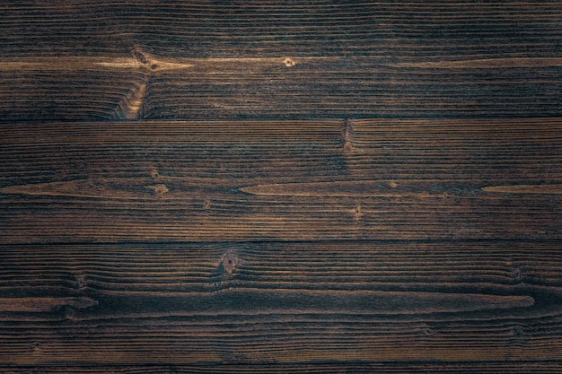 Struttura di legno marrone scuro con sfondo naturale modello a strisce