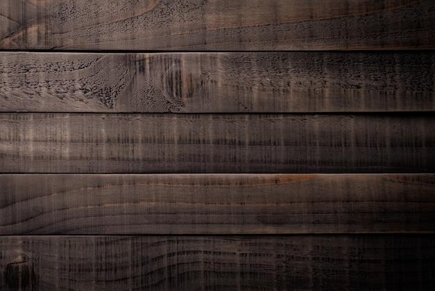 Struttura di legno marrone scuro e nero, tavolo in legno.