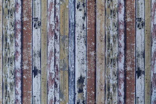 Struttura di legno variopinta e vecchia o fondo o carta da parati d'annata.