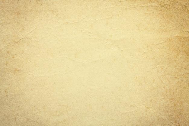 Struttura di vecchia carta beige, fondo sgualcito. sfondo di superficie grunge sabbia vintage.