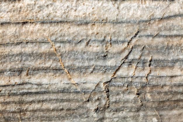 Struttura di vecchia colonna grigia antica, primo piano, fondo. spazio per il testo