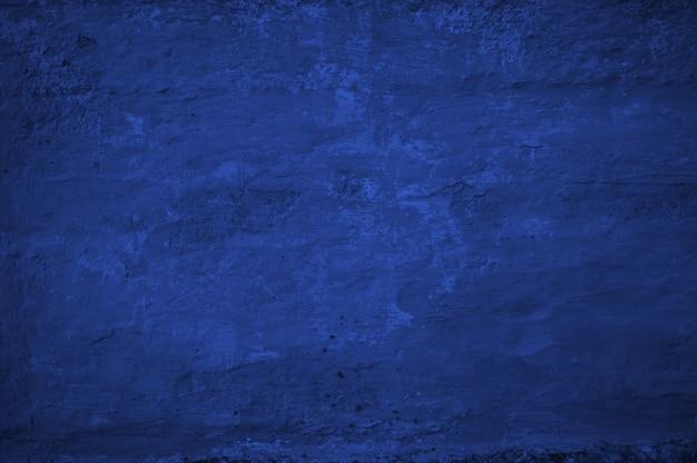 Struttura di vecchio fondo blu della parete dello stucco di colore