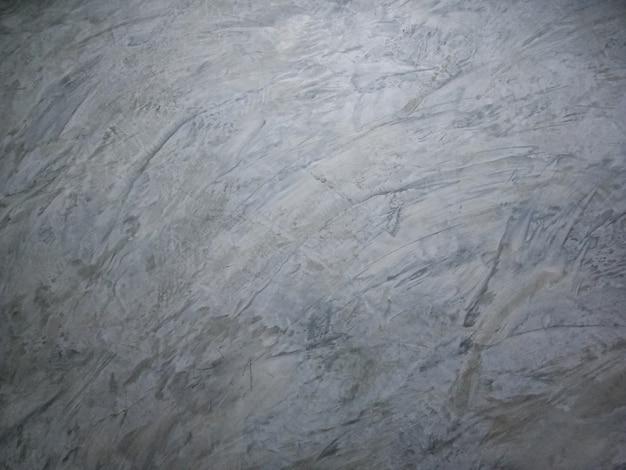 Struttura di vecchio fondo grigio del muro di cemento