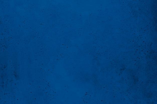 Struttura di vecchio muro di cemento in blu classico
