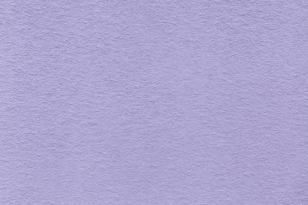 Struttura di vecchio primo piano di carta viola-chiaro