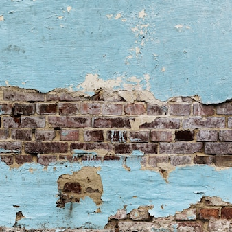 Struttura dipinta sbucciata dei mura di mattoni