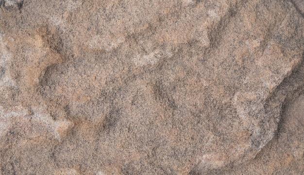 Struttura e fondo astratto del pavimento di pietra marrone