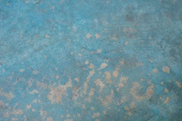 Struttura e fondo blu concreti della parete con copyspace