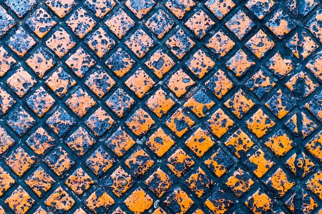 Struttura e fondo di colore arancio della lamina di metallo