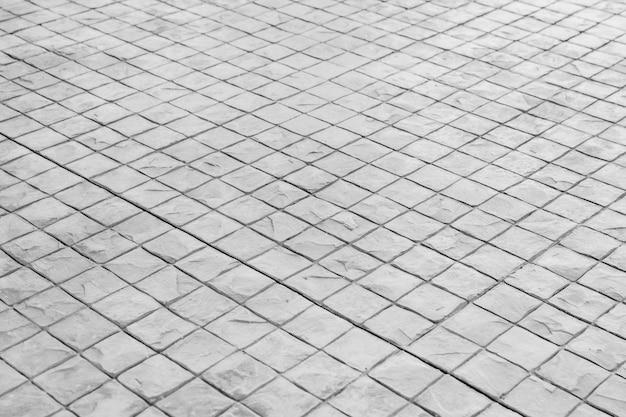 Struttura in bianco e nero del fondo del pavimento di pietra