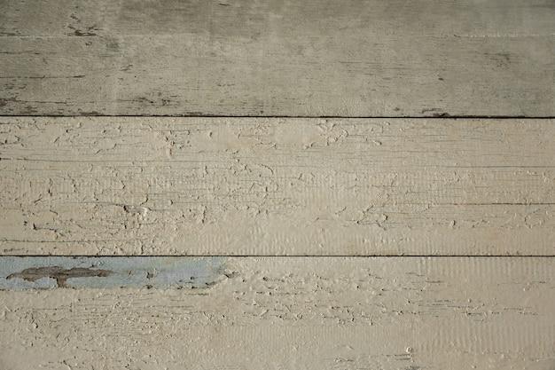 Struttura in legno. tavolo o parete. fondo di legno della vecchia plancia bianca del tempo. stile retrò vintage