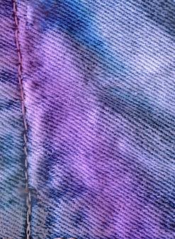 Struttura pulita blu del denim di vista del primo piano. trama blu jeans strappati