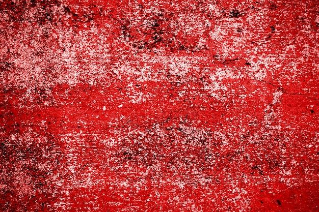 Struttura rossa della parete del cemento di lerciume
