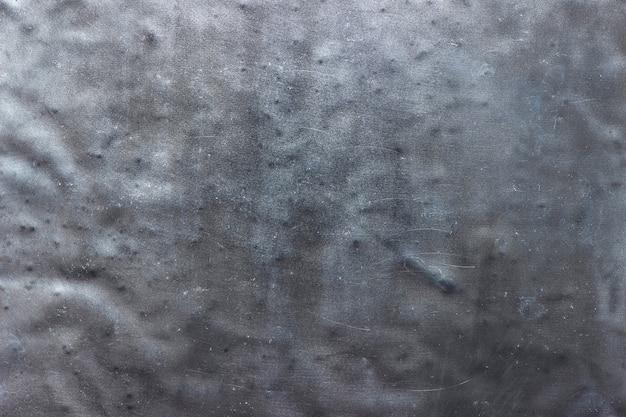 Struttura rustica del metallo, parete scura dell'acciaio del fondo