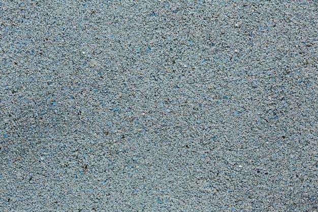 Struttura stradale granulosa grigia asfaltata