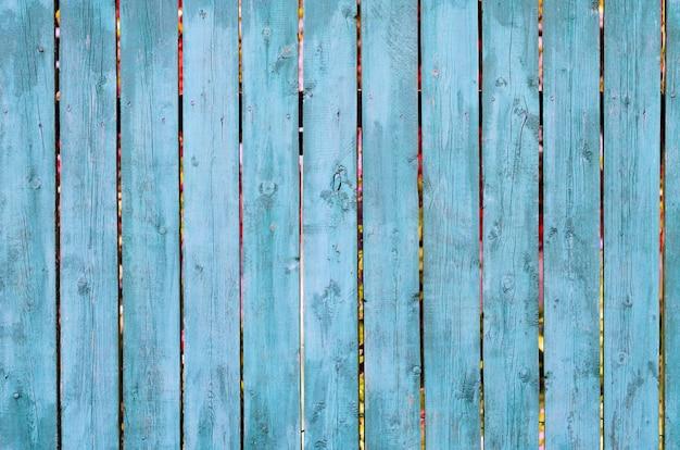 Struttura verde e blu stagionata incrinata del bordo di legno, vista frontale