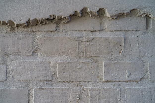 Struttura vuota del muro di mattoni. priorità bassa bianca verniciata della superficie del stonewall del grunge.