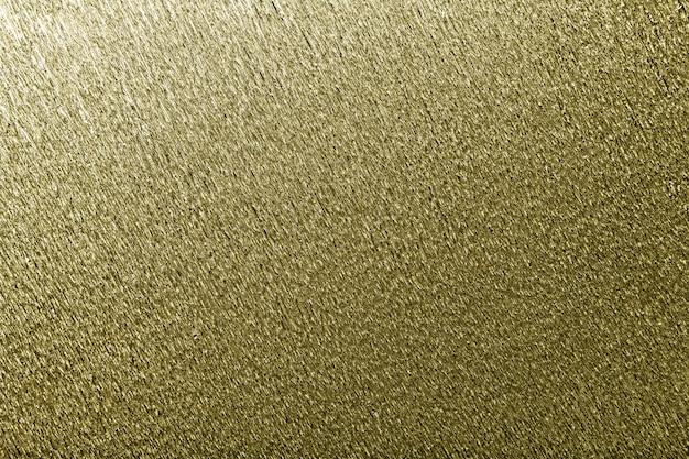 Strutturale di carta ondulata ondulata dorata, primo piano.