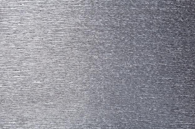 Strutturale di carta ondulata ondulata grigia, primo piano.