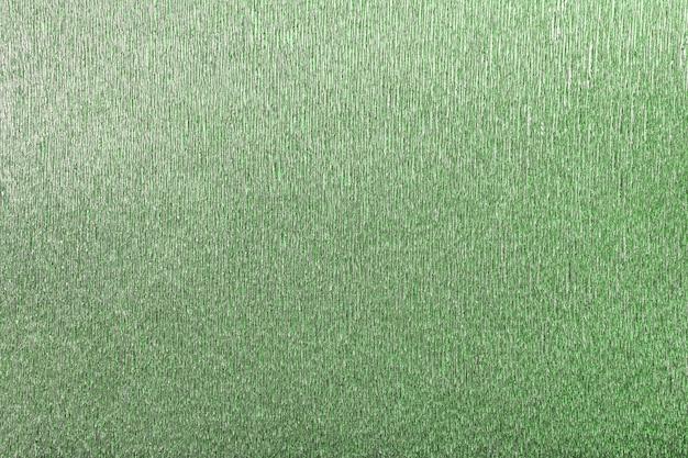 Strutturale di fondo verde di carta ondulata ondulata, primo piano.